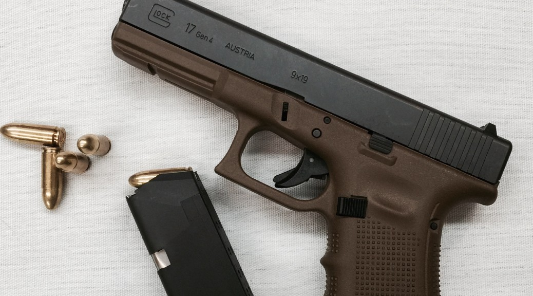 GLOCK G17 Gen4 in Flat Dark Earth with one magazine and a few 9x19mm Parabellum cartridges.